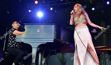 Jeff Goldblum, of Jeff Goldblum and the Mildred Snitzer Orchestra, left, and Haley Reinhart perform on day 1 of the Arroyo Seco Music Festival, in Pasadena, Calif