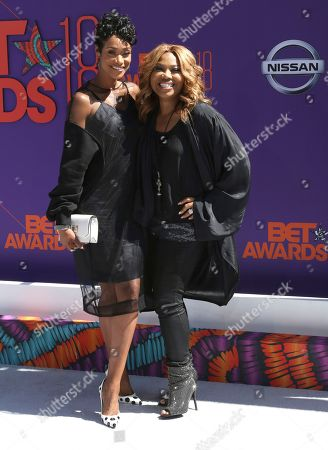 Tami Roman, left, and Mona Scott-Young arrive at the BET Awards at the Microsoft Theater, in Los Angeles