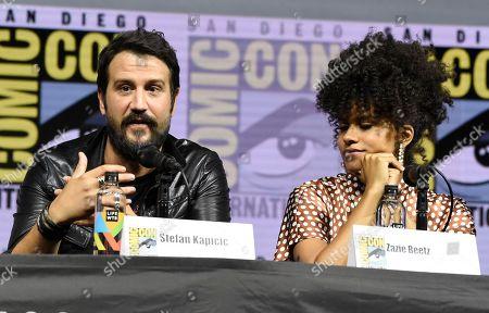"Stefan Kapicic, left, speaks as Zazie Beetz looks on at the ""Deadpool 2"" panel on day three of Comic-Con International, in San Diego"
