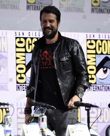 """Stefan Kapicic walks on stage at the """"Deadpool 2"""" panel on day three of Comic-Con International, in San Diego"""
