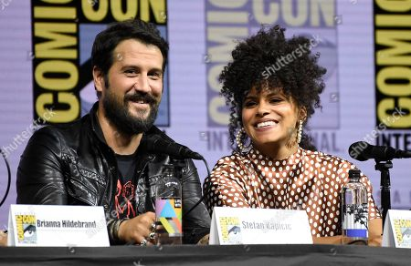 """Stefan Kapicic, left, and Zazie Beetz attend the """"Deadpool 2"""" panel on day three of Comic-Con International, in San Diego"""