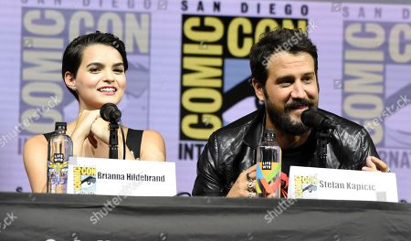"""Brianna Hildebrand, left, and Stefan Kapicic speak at the """"Deadpool 2"""" panel on day three of Comic-Con International, in San Diego"""
