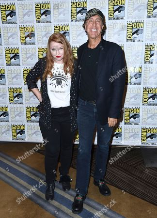 """Sarah Schechter, left, and Jon Goldwater attend the """"Riverdale"""" press line on day three of Comic-Con International, in San Diego"""