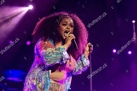 Jill Scott performs at the 2018 Essence Festival at the Mercedes-Benz Superdome, in New Orleans