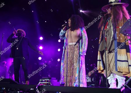 Black Thought left, Jill Scott and Erykah Badu perform at the 2018 Essence Festival at the Mercedes-Benz Superdome, in New Orleans
