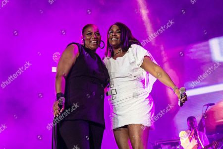 Queen Latifah, left, and Deidra Roper (DJ Spinderella) perform at the 2018 Essence Festival at the Mercedes-Benz Superdome, in New Orleans