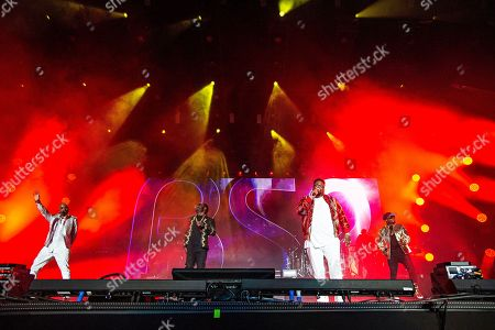 Stock Picture of Teddy Hollister (left) and Dave Hollister (3rd from left) of Blackstreet perform at the 2018 Essence Festival at the Mercedes-Benz Superdome, in New Orleans
