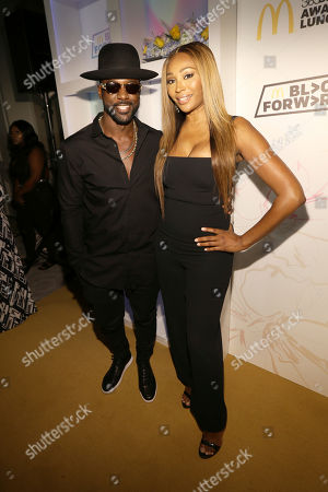 Actor Lance Gross and Entrepreneur and Television Personality Cynthia Bailey are seen at the 15th Annual 365Black Awards during the Essence Music Festival on