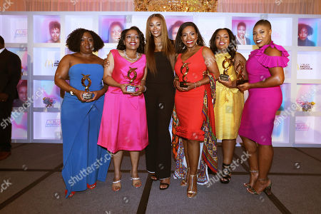 Stock Photo of Founder and CEO of Black Girls CODE Kimberly Bryant, McDonald's Owner / Operator, Monique Vann-Brown, Entrepreneur and Television Personality Cynthia Bailey, Actress and activist Sheryl Lee Ralph, HBCU Forward Scholarship award recipient Tishauna Wilson, and Political Commentator Symone Sanders are seen at the 15th Annual 365Black Awards during the Essence Music Festival on