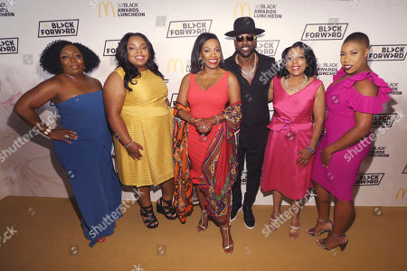 From left to right, founder and CEO of Black Girls CODE Kimberly Bryant, HBCU Forward Scholarship award recipient Tishauna Wilson, actress and activist Sheryl Lee Ralph, actor Lance Gross, McDonald's owner / operator Monique Vann-Brown, and political commentator Symone Sanders pose at the 15th annual 365Black Awards during the Essence Music Festival, in New Orleans