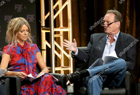 """Stock Photo of Kaitlin Olson, left, and Gregory Scott Cummins participate in a table read during a panel for """"It's Always Sunny in Philadelphia"""" during the FX Television Critics Association Summer Press Tour at The Beverly Hilton hotel, in Beverly Hills, Calif"""