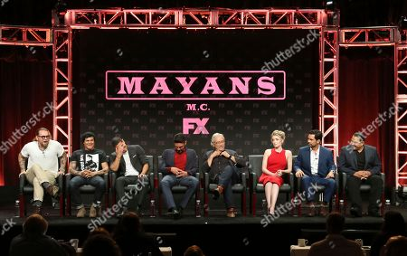 """Kurt Sutter, co-creator/executive producer/writer, from left, Elgin James, co-creator/executive producer/writer/director, JD Pardo, Clayton Cardenas, Edward James Olmos, Sarah Bolger, Danny Pino and Emilio Rivera participate in the """"Mayans M.C."""" panel during the FX Television Critics Association Summer Press Tour at The Beverly Hilton hotel, in Beverly Hills, Calif"""