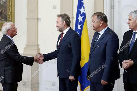 U.S. Senator Roger Wicker, left, shake hands with Bosnian Muslim member of Bosnia's tripartite Presidency, standing next to Bakir Izetbegovic, Bosnian Serb member of Bosnia's tripartite Presidency and Mladen Ivanic and Bosnian Croat member of Bosnia and Herzegovina's tripartite Presidency Dragan Covic, during a visit, in Sarajevo