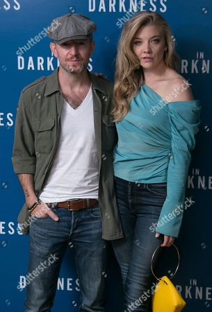 Actress Natalie Dormer and director Anthony Byrne pose for photographers upon arrival at the screening of In Darkness in central London