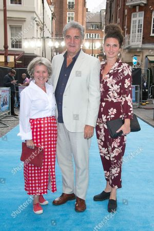 Imelda Staunton, Jim Carter and Bessie Carter pose for photographers upon arrival at the UK premiere Swimming With Men in central London