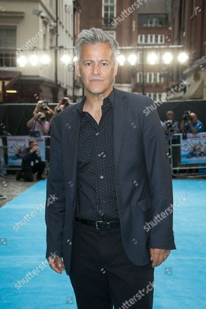 Rupert Graves poses for photographers upon arrival at the UK premiere Swimming With Men in central London