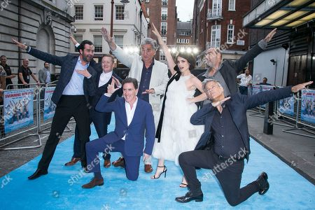 Actors from left to right, Daniel Mays, Thomas Turgoose, Rob Brydon, Jim Carter, Charlotte Riley, Oliver Parker and Rupert Graves, front right, pose for photographers upon arrival at the UK premiere Swimming With Men in central London