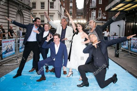 Stock Photo of Actors from left to right, Daniel Mays, Thomas Turgoose, Rob Brydon, Jim Carter, Charlotte Riley, Oliver Parker and Rupert Graves, front right, pose for photographers upon arrival at the UK premiere Swimming With Men in central London