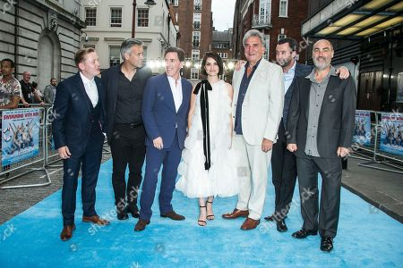 Actors from left to right, Thomas Turgoose, Rupert Graves, Rob Brydon, Jim Carter, Charlotte Riley, Daniel Mays and Oliver Parker, pose for photographers upon arrival at the UK premiere Swimming With Men in central London