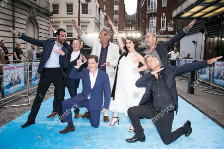 Actors Daniel Mays,from left, Thomas Turgoose, Rob Brydon, Jim Carter, Charlotte Riley, Oliver Parker and Rupert Graves, front right, pose for photographers upon arrival at the premiere of the film Swimming With Men in central London