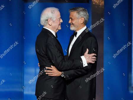 Actor-director George Clooney, right, is greeted by his father Nick Clooney at the 46th AFI Life Achievement Award gala honoring him in Los Angeles. The American Film Institute hosted a star-studded gala earlier this month to honor George Clooney's achievements as an actor, director and activist. TNT is airing the gala on Thursday at 10 p.m. Eastern and Pacific