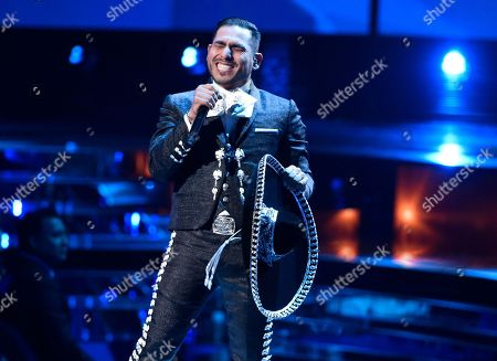 """Espinoza Paz performs """"Perdi La Pose"""" at the 16th annual Latin Grammy Awards in Las Vegas. Paz will join other artists at the 2nd edition of the Los Dells festival in Wisconsin in September"""