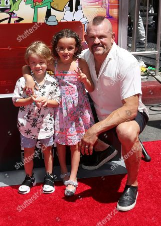 "Chuck Liddell, right, and his family arrive at the LA Premiere of ""Teen Titans Go! To the Movies"" at the TCL Chinese Theatre, in Los Angeles"