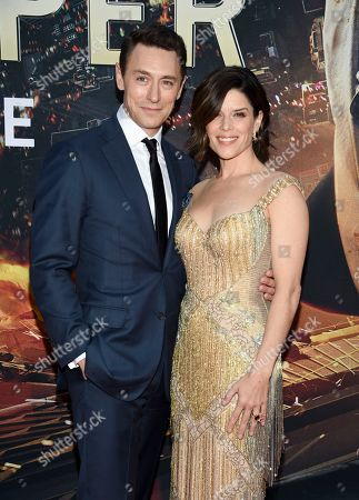 """Actress Neve Campbell and boyfriend JJ Feild attend the """"Skyscraper"""" premiere at AMC Loews Lincoln Square, in New York"""