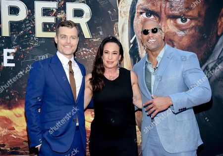 "Stock Photo of Director Rawson Marshall Thurber, left, producer Dany Garcia and actor Dwayne Johnson attend the ""Skyscraper"" premiere at AMC Loews Lincoln Square, in New York"