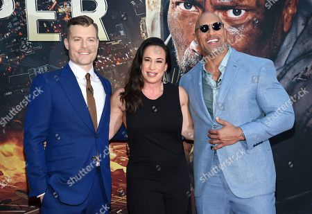 """Stock Photo of Director Rawson Marshall Thurber, left, producer Dany Garcia and actor Dwayne Johnson attend the """"Skyscraper"""" premiere at AMC Loews Lincoln Square, in New York"""