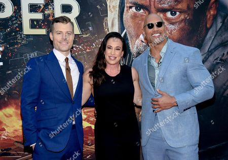 "Stock Picture of Director Rawson Marshall Thurber, left, producer Dany Garcia and actor Dwayne Johnson attend the ""Skyscraper"" premiere at AMC Loews Lincoln Square, in New York"