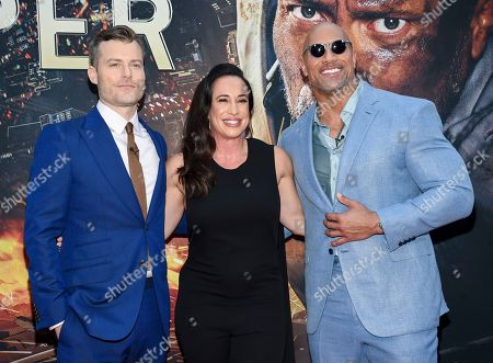 """Director Rawson Marshall Thurber, left, producer Dany Garcia and actor Dwayne Johnson attend the """"Skyscraper"""" premiere at AMC Loews Lincoln Square, in New York"""