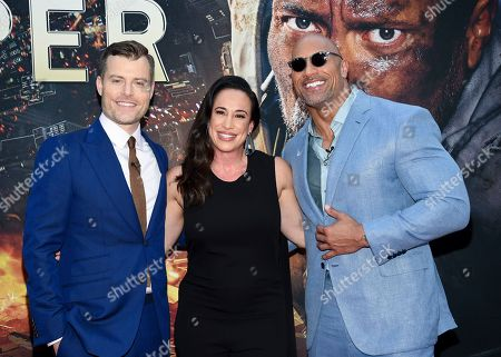 "Director Rawson Marshall Thurber, left, producer Dany Garcia and actor Dwayne Johnson attend the ""Skyscraper"" premiere at AMC Loews Lincoln Square, in New York"
