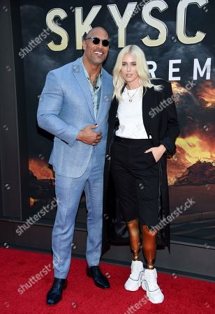 """Actor Dwayne Johnson, left, and model Lauren Wasser attend the """"Skyscraper"""" premiere at AMC Loews Lincoln Square, in New York"""