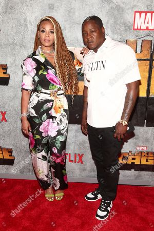 """Faith Evans, left, and Jadakiss, right, attend the premiere of the Netflix original series Marvel's """"Luke Cage"""" season two at The Edison Ballroom, in New York"""