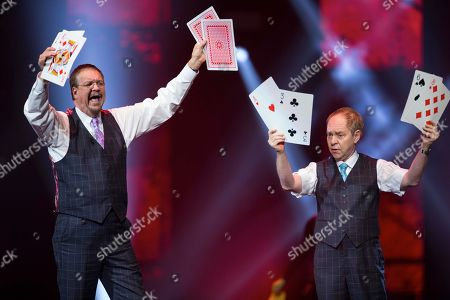 """Penn Jillette, left, and Raymond Teller perform their """"Penn & Teller"""" act at the Vegas Strong Benefit concert in Las Vegas. The duo cancelled a performance scheduled for Friday, July 6, in Biloxi, Miss., because Teller's back injury has flared up"""