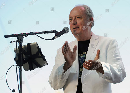 """Michael Nesmith performs on the third day of the 2014 Stagecoach Music Festival in Indio, Calif. The Monkees have postponed the last four dates of their tour after Nesmith became ill. The band posted on Facebook, that Nesmith had """"a minor health issue"""" before a show in Philadelphia and was advised to """"rest for the next week."""" He has been performing past hits in """"The Monkees Present: The Mike & Micky Show"""" tour with 73-year-old bandmate Micky Dolenz"""