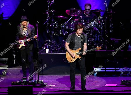 The American iconic rock band, The Doobie Brothers with original member guitarist Patrick Simmons, founding member and lead guitarist Tom Johnston, and drummer Ed Both performs at the Xfinity Center, in Mansfield, Mass