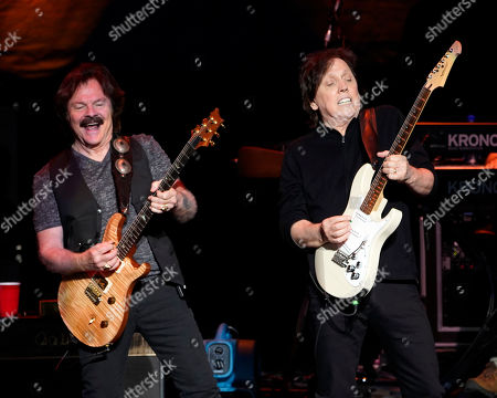 The American iconic rock band, The Doobie Brothers with lead guitarist Tom Johnston and guitarist John McFee performs at the Xfinity Center, in Mansfield, Mass