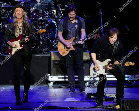 Stock Photo of American iconic rock band The Doobie Brothers with original members guitarist Patrick Simmons, left, lead guitarist and founding member Tom Johnston, center, and guitarist John McFee perform at the Xfinity Center, in Mansfield, Mass