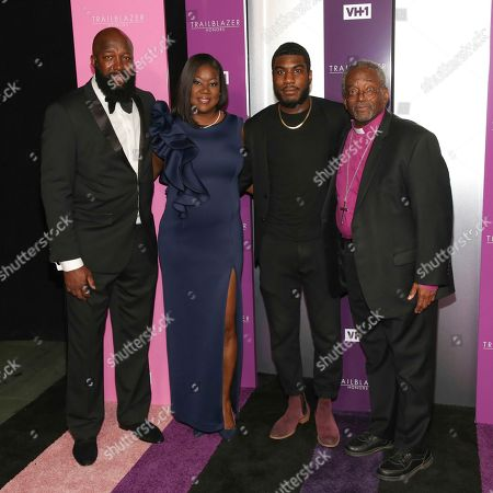 Honorees Tracy Martin, from left, Sybrina Fulton pose with Jahvaris Martin and Bishop Michael Curry during VH1's Trailblazer Honors at the Cathedral of St. John the Divine, in New York
