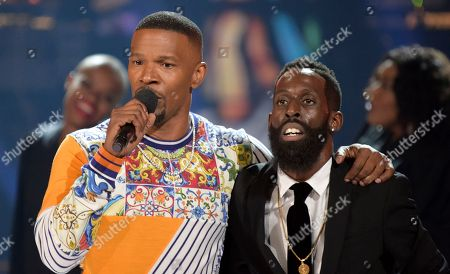 Jamie Foxx, left, and Tye Tribbett appear on stage at the conclusion of the BET Awards at the Microsoft Theater, in Los Angeles