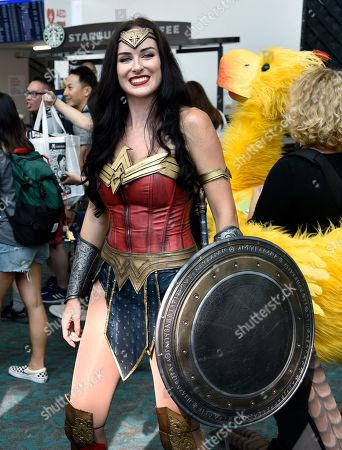 Jessica Rose Davis, of Los Angeles, dressed as Wonder Woman, attends day one of Comic-Con International, in San Diego
