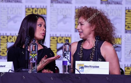 "Valarie Pettiford, left, and Alex Kingston attend the ""A Discovery of Witches"" panel on day one of Comic-Con International, in San Diego"