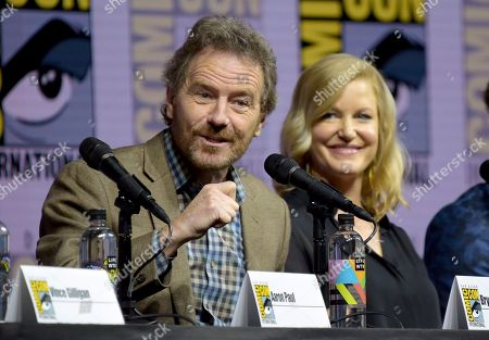 """Bryan Cranston, left, and Anna Gunn attend the """"Breaking Bad"""" 10th Anniversary panel on day one of Comic-Con International, in San Diego"""