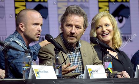 """Aaron Paul, from left, Bryan Cranston and Anna Gunn attend the """"Breaking Bad"""" 10th Anniversary panel on day one of Comic-Con International, in San Diego"""