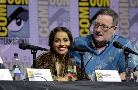 "Mandip Gill, left, and Chris Chibnall attend the ""Doctor Who"" panel on day one of Comic-Con International, in San Diego"