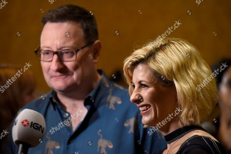 "Chris Chibnall, left, and Jodie Whittaker arrive at the ""Doctor Who"" press line on day one of Comic-Con International, in San Diego"