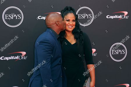 Former NFL football player Curtis Conway, left, and his wife, former boxer Laila Ali, arrive at the ESPY Awards at Microsoft Theater, in Los Angeles