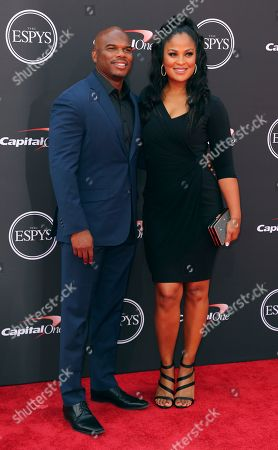 Former NFL football player Curtis Conway, left, and wife, former professional boxer Laila Ali arrive at the ESPY Awards at the Microsoft Theater, in Los Angeles